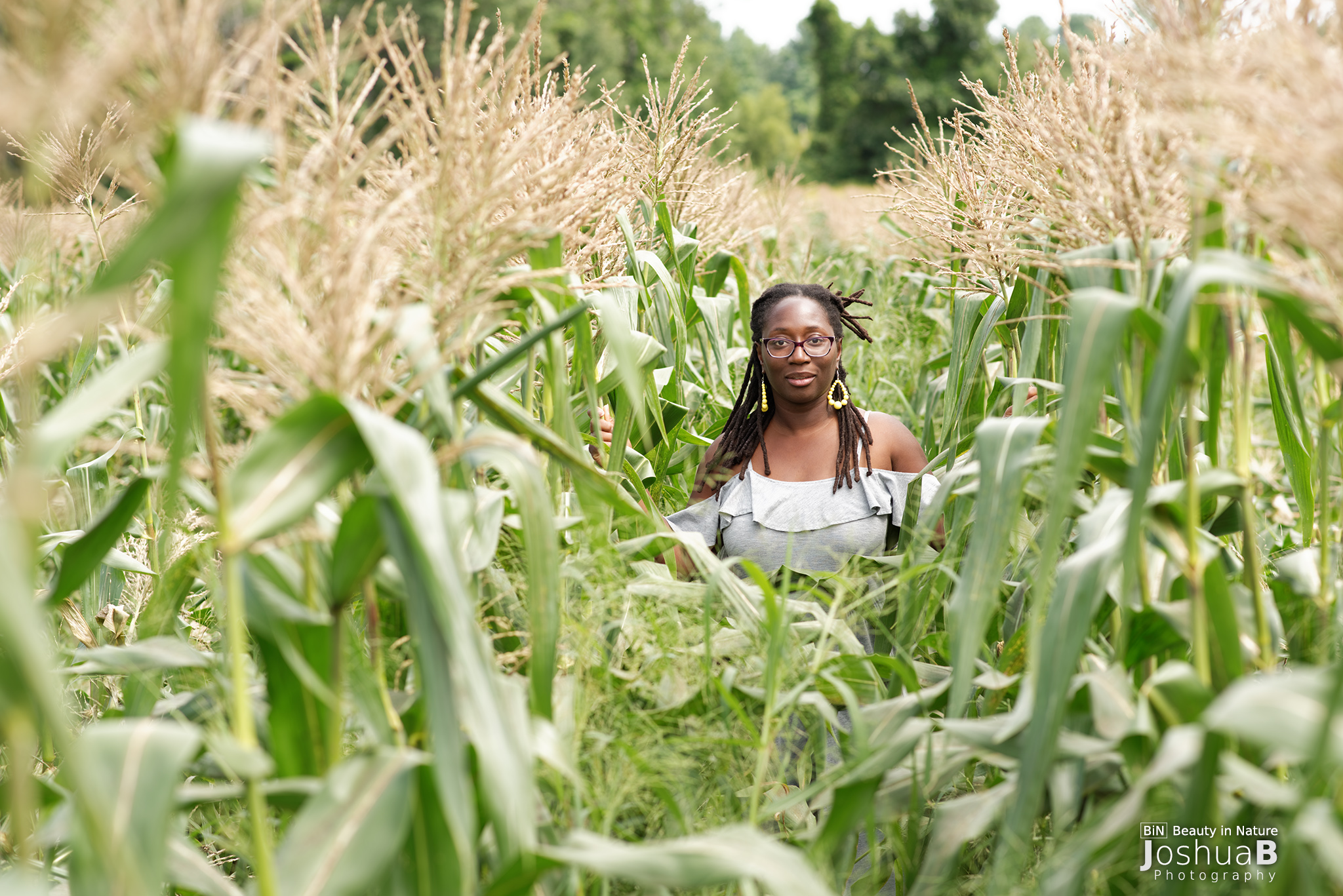 black woman dreadlocks cornfield
