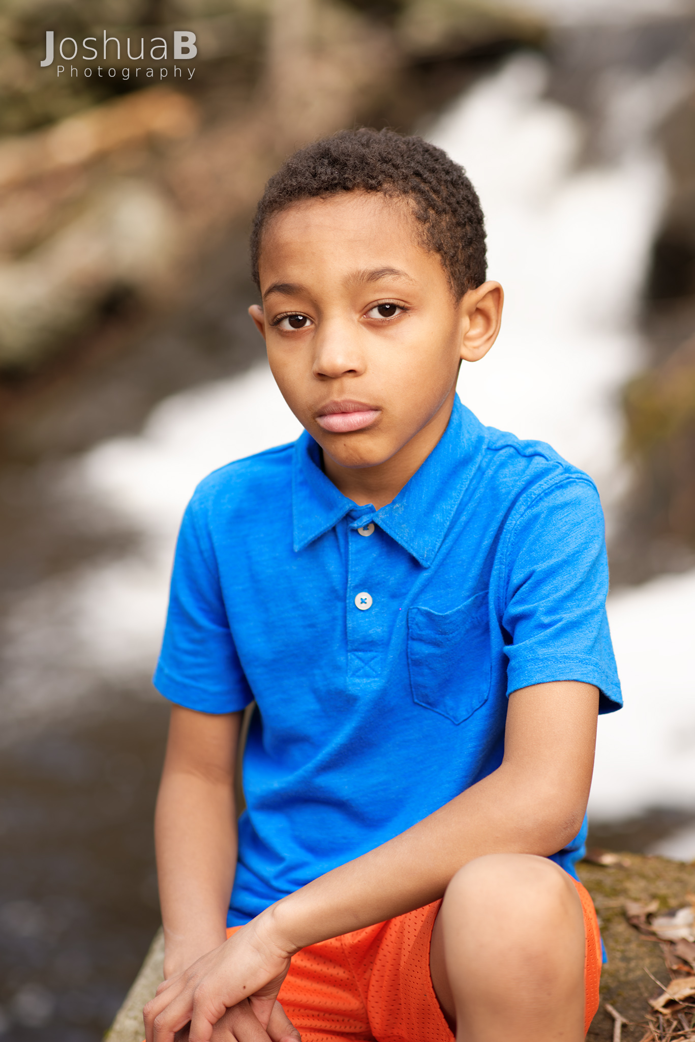 8 year old boy with waterfall background