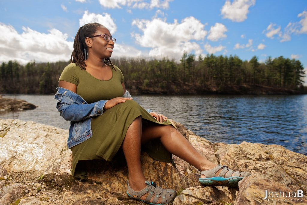 woman with dreadlocks on the Wachusett Reservoir rocky coast