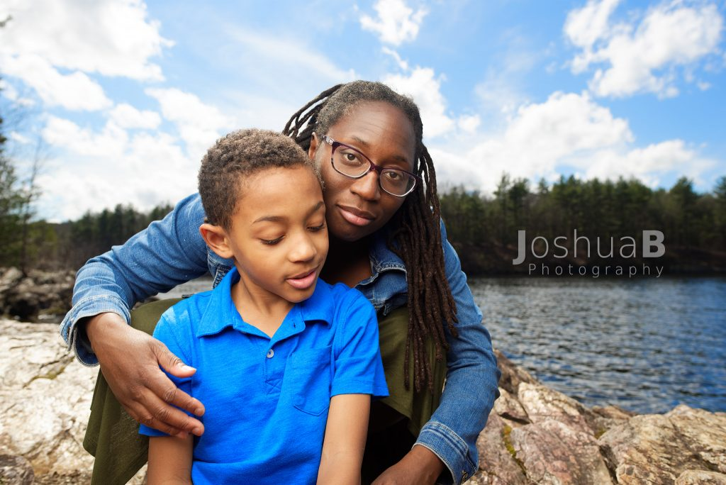 mother & son rocky coast lake