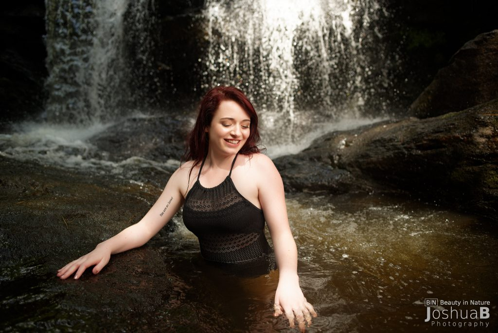 beautiful woman black bathing suit waterfall