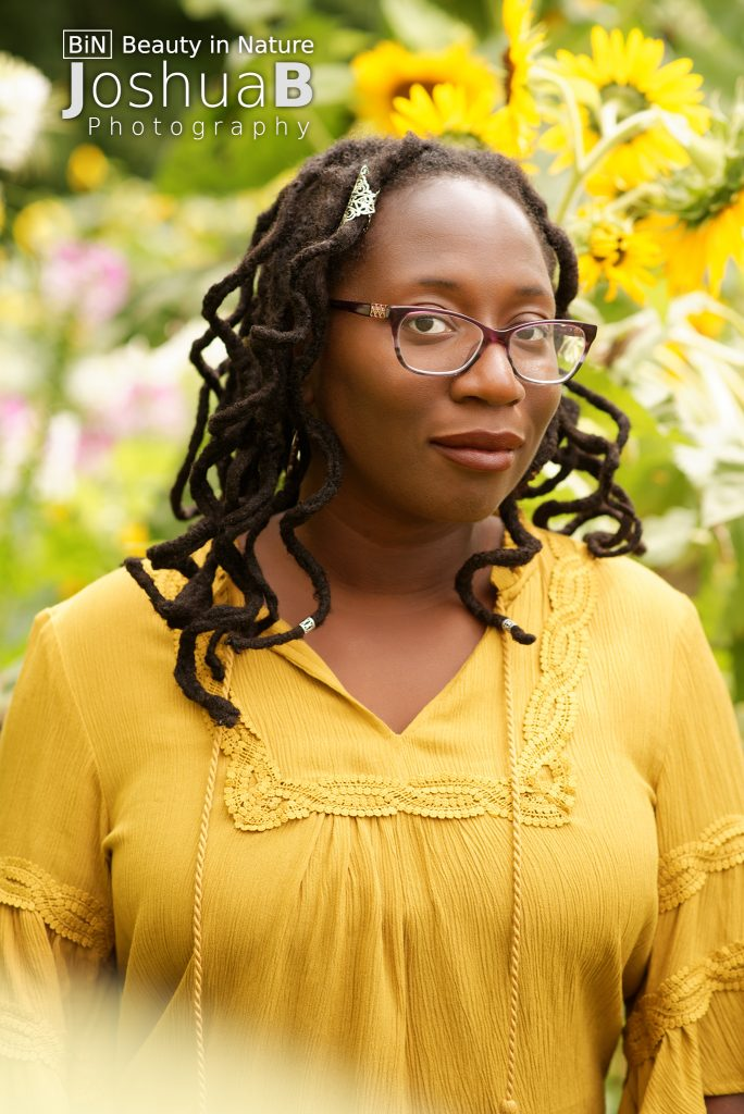 beautiful black woman dreads flowers yellow