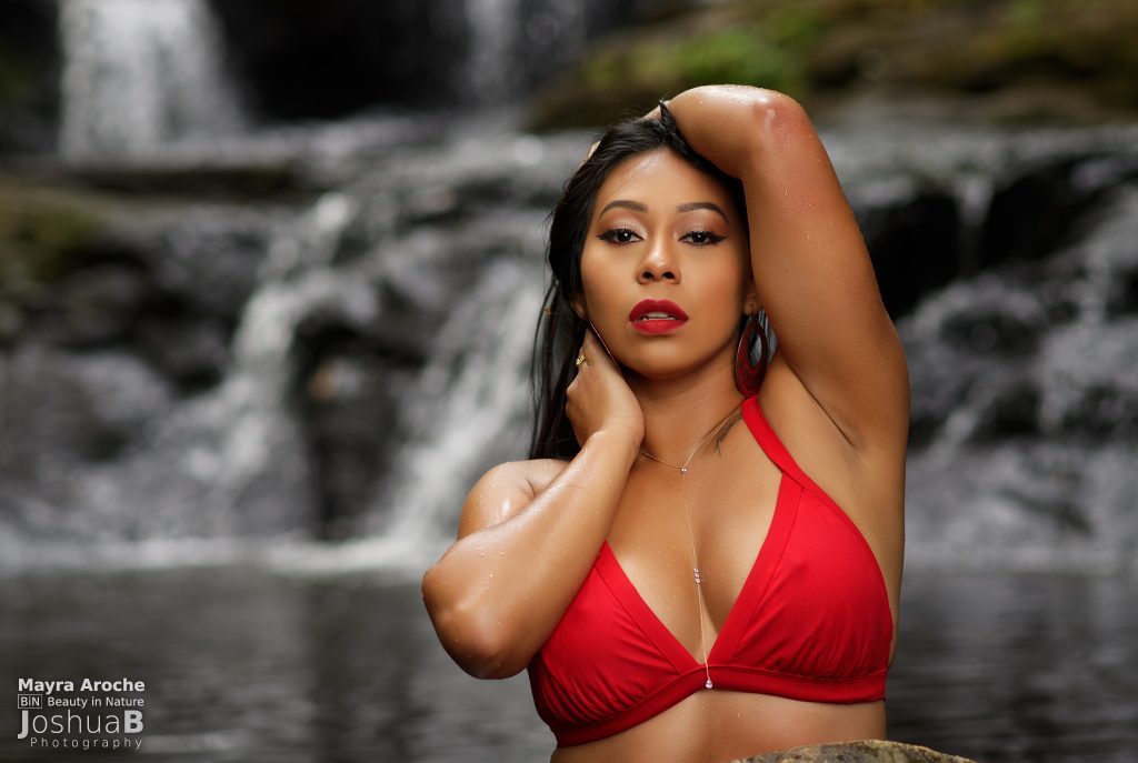 Latina posing in red bikini waterfall