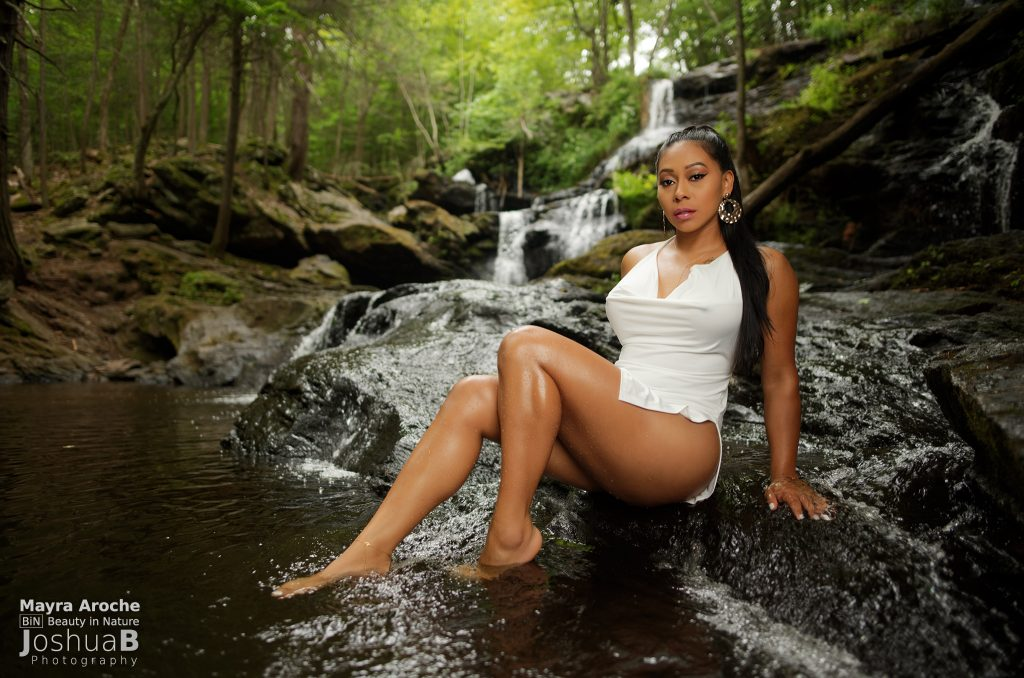 Latina sitting in waterfall white dress