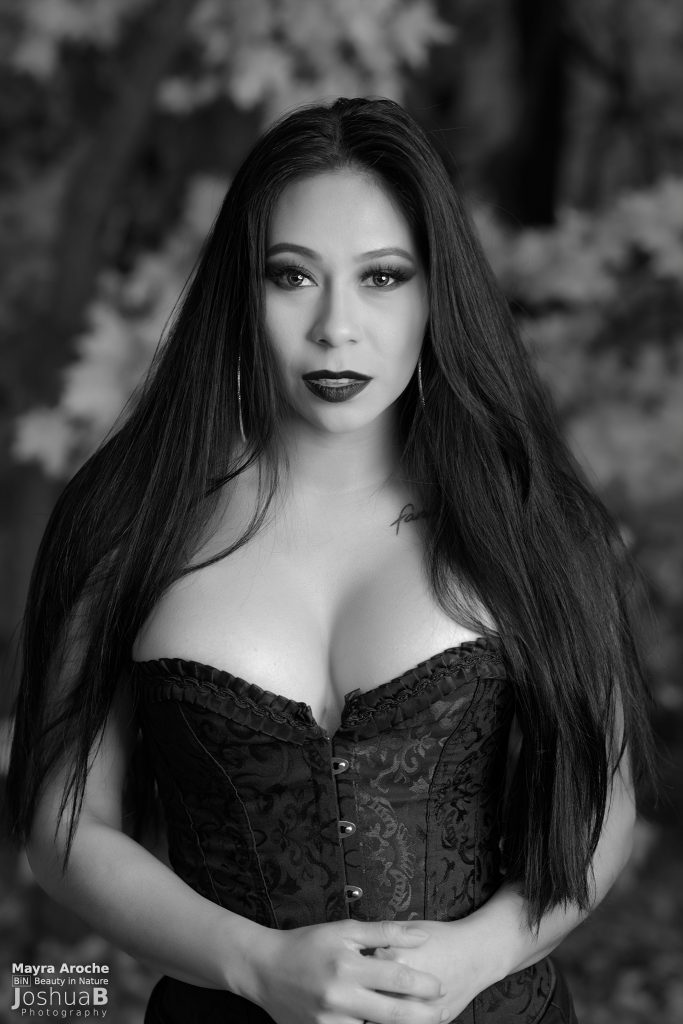 Sexy Latina in Halloween makeup wearing black corset