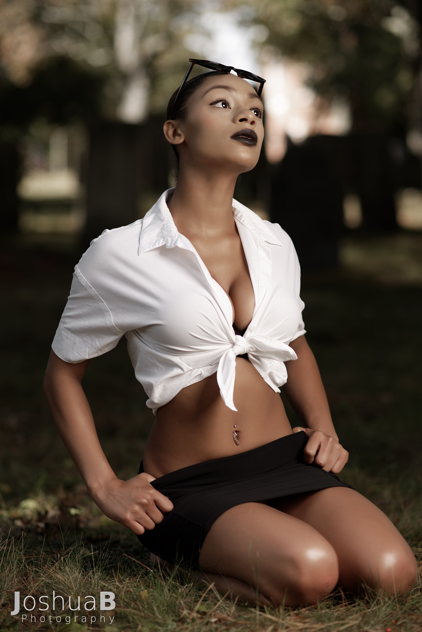 Beautiful Latina in sexy school girl Halloween outfit, looking up