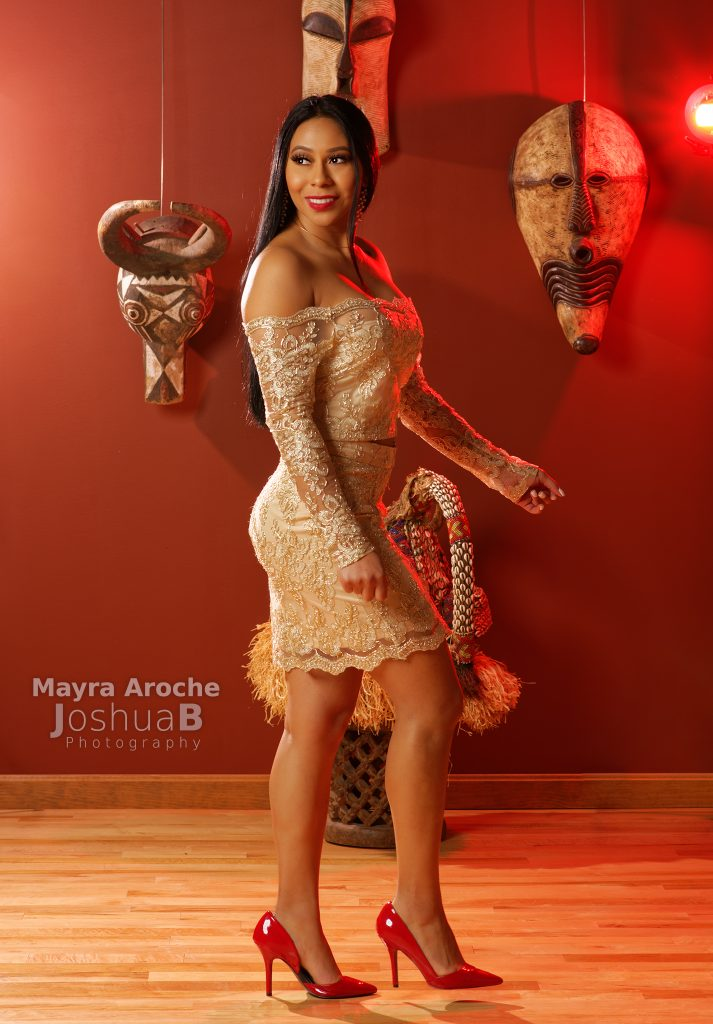 Mayra Aroche in cream colored, sheer dress african masks