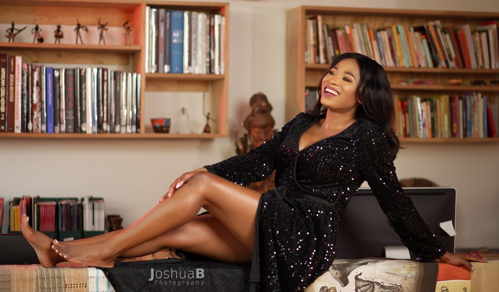 Abidemi Oke modeling in black sequin dress