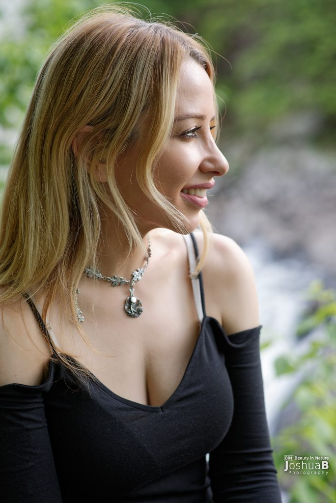 Kate Eppers in black at waterfall