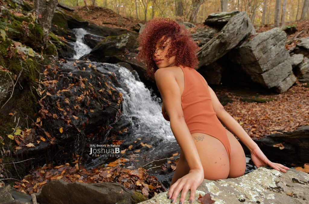 Tysheika Perez looking back, modeling at Connecticut waterfall